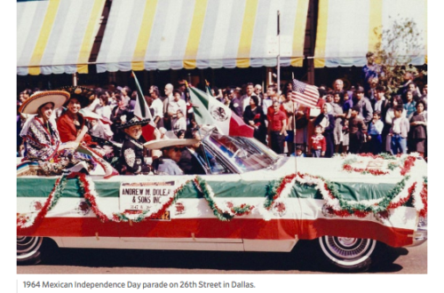 A decked out red white and green convertible (e.g. the colors of the Mexican flag), driving down a crowded parade street